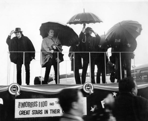 The Beatles arrive at Sydney airport in torrential rain on June 11, 1964. With them is stand-in drummer Jimmie Nicol.