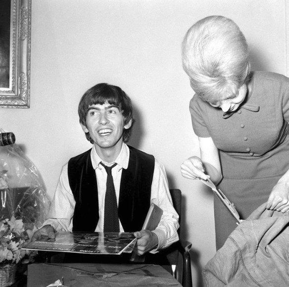 Pop Group The Beatles February 1964 George Harrison Beatle George Harrison 21st birthday sorting through the 52 sacks full of gr
